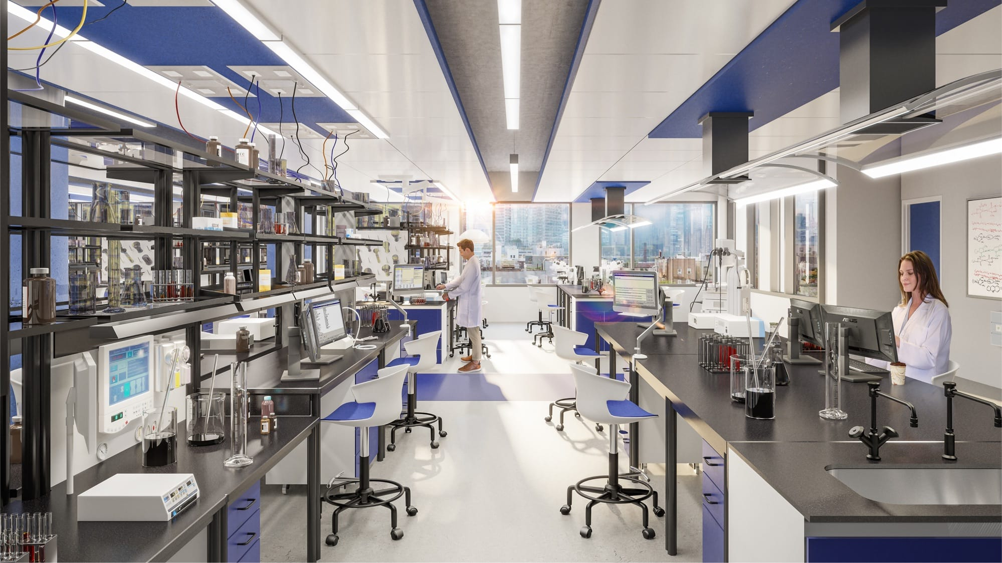 A male and female scientist work in state-of-the-art lab space at Innolabs